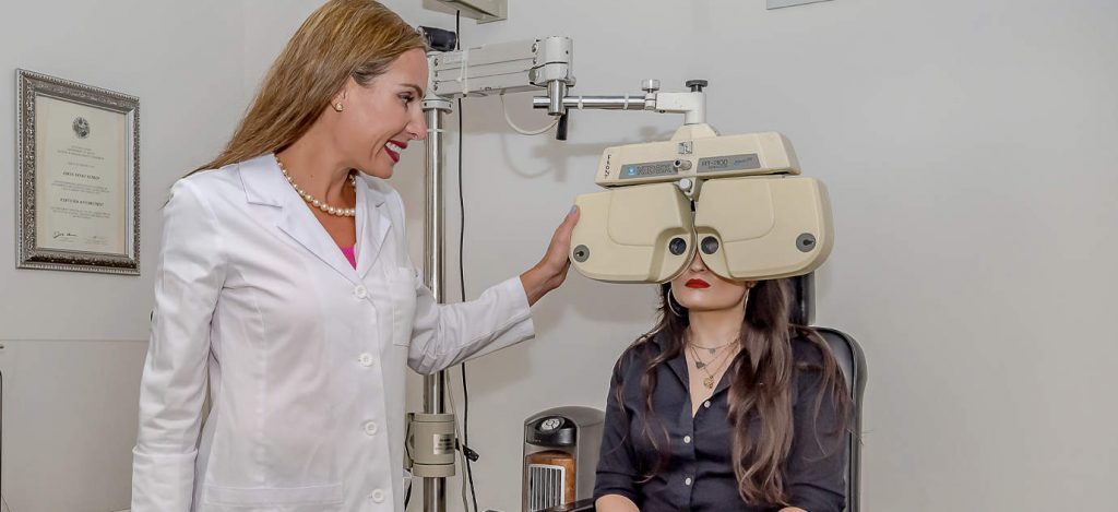 Picture of Dr. Adina Gould giving an eye exam.