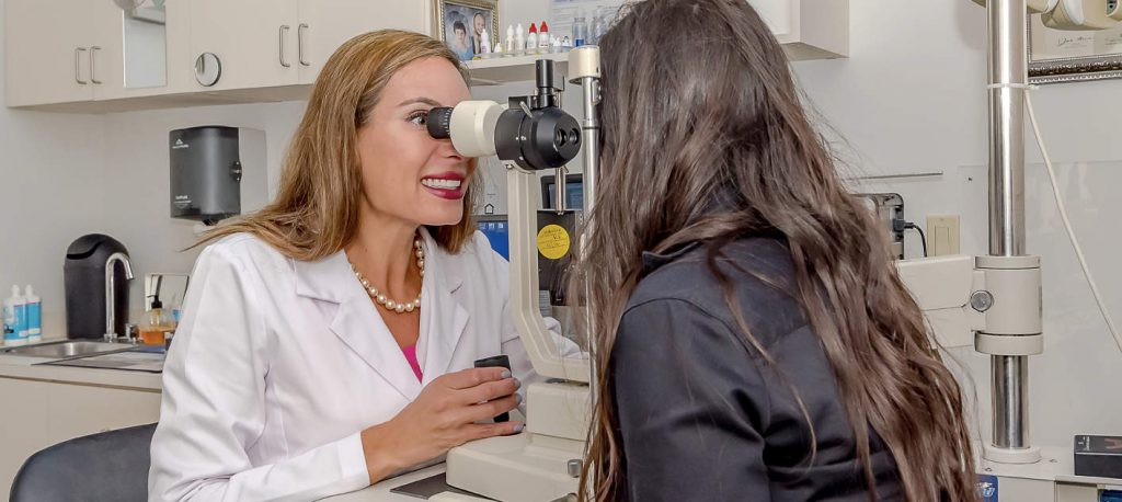 Dr. Adina Gould giving an eye exam.